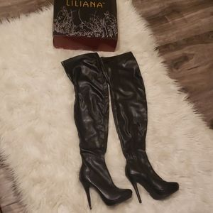 Black leather thigh high heeled boots